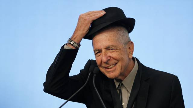 Cohen tips his hat as he accepts the 2012 Awards for Song Lyrics of Literary Excellence in Boston