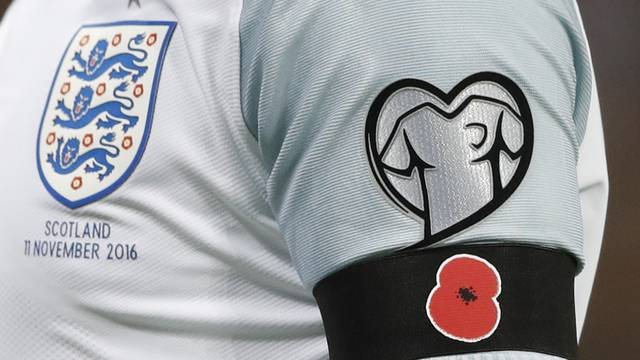 England's Wayne Rooney with a poppy armband