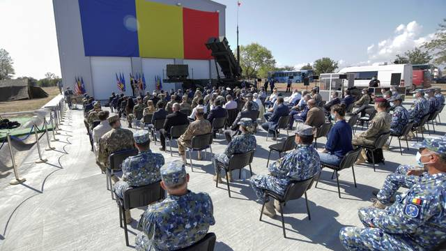 Romanian PM Ludovic Orban delivers a speech during an event that marked the delivery of the first Patriot surface-to-air missile systems to Romanian Army