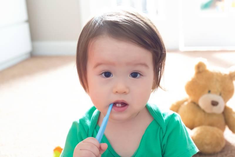 Toddler boy brushing his teeth