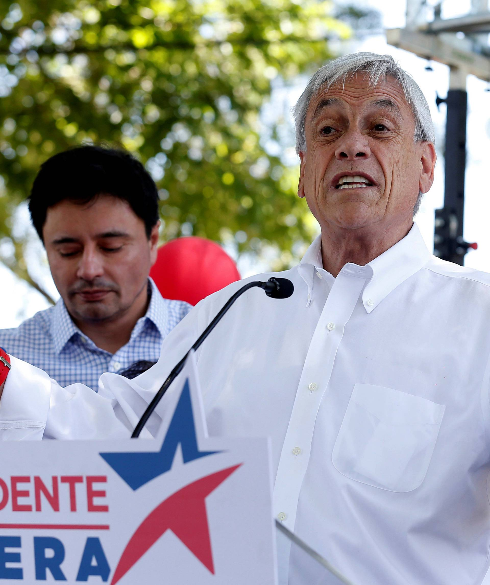 Chilean presidential candidate Sebastian Pinera speaks and takes part in a campaign rally in Santiago