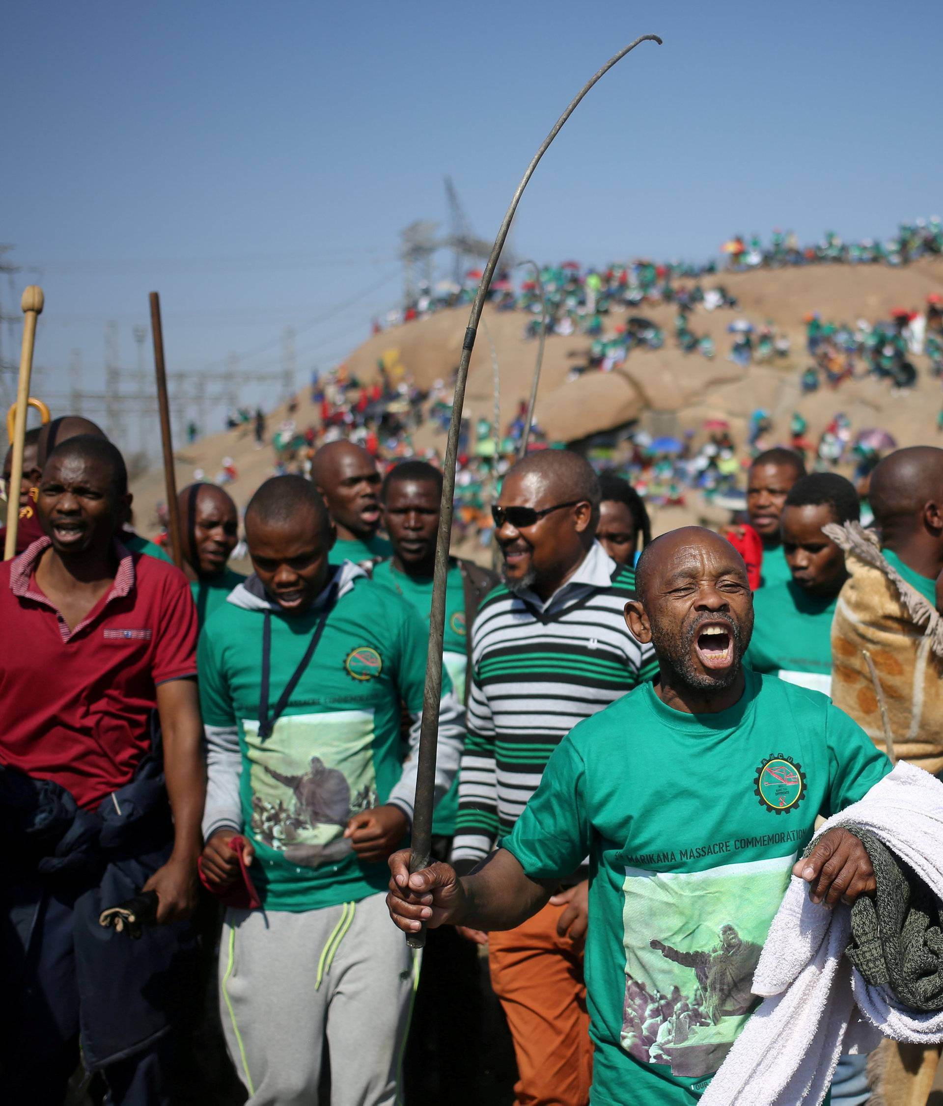 FILE PHOTO: Miners and members of the Association of Mineworkers and Construction Union (AMCU) sing during the 5th-year anniversary commemorations in Rustenburg