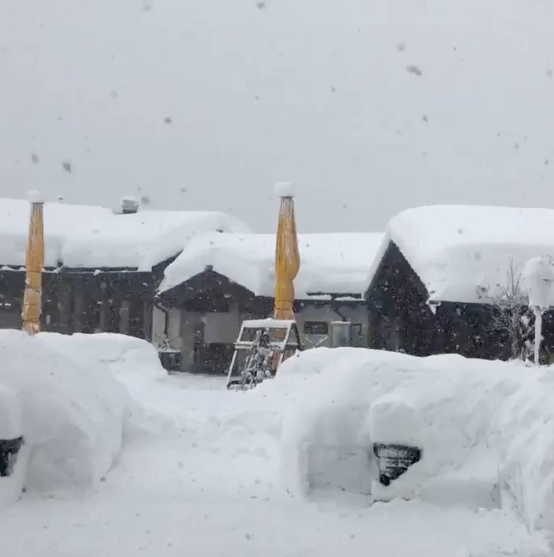 A hotel covered in snow is seen in Zermatt resort