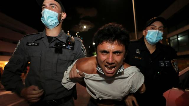Israelis protest against law that limits protests during the coronavirus disease (COVID-19) lockdown, in Tel Aviv