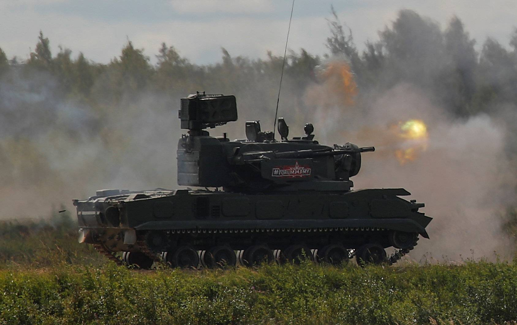 """A Russian 2K22 Tunguska anti-aircraft vehicle fires during a demonstration at the annual international military-technical forum """"ARMY"""" in Alabino"""
