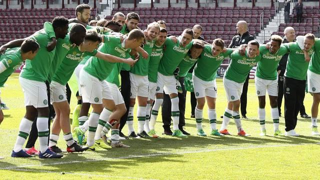 Celtic players celebrate winning the Scottish Premiership