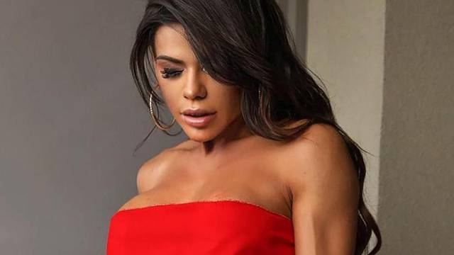 Festive Fantasy! Miss BumBum Suzy Cortez strips down to a red ribbon as she gets into the Christmas spirit.