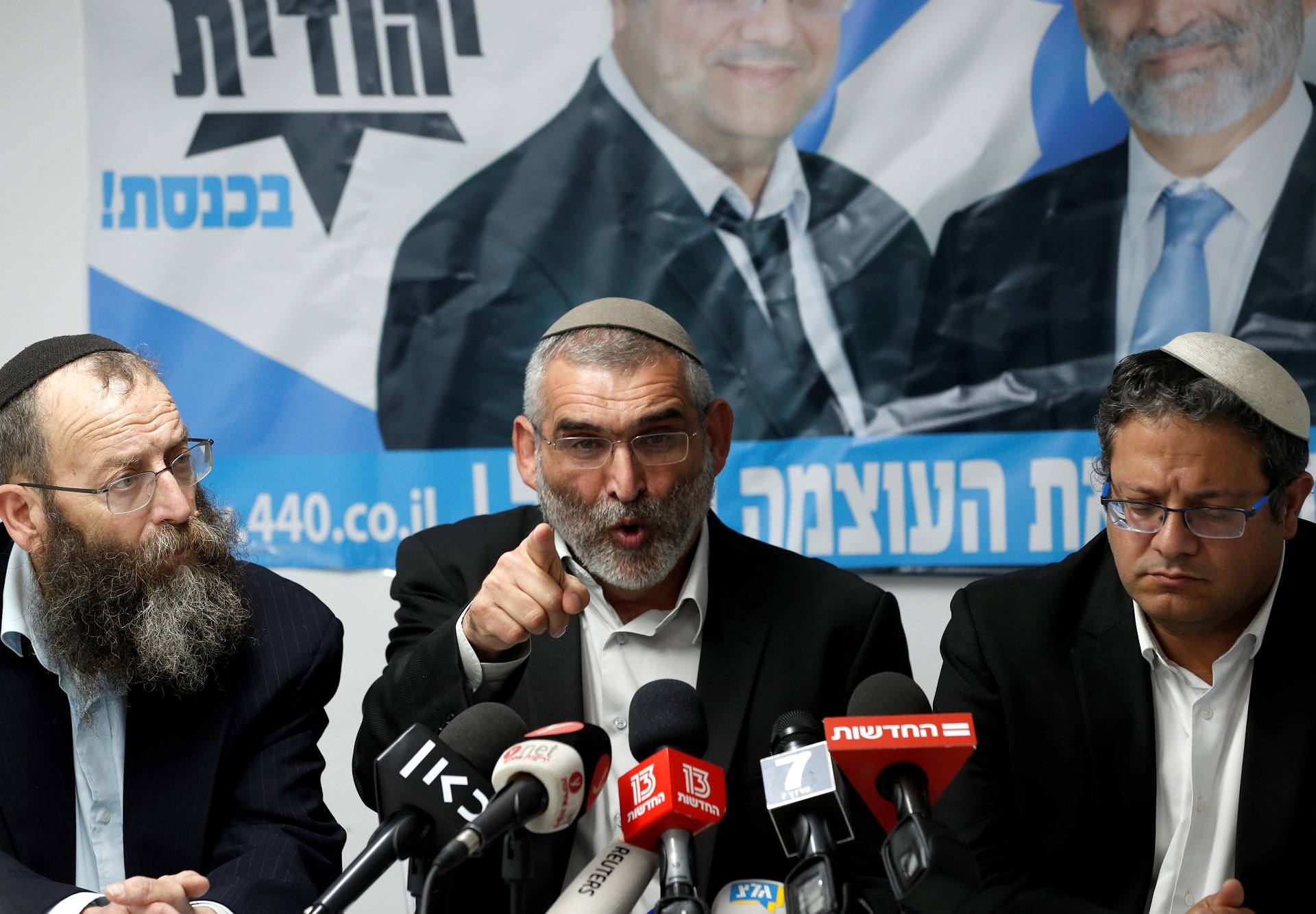 Michael Ben-Ari from the Jewish Power party delivers a statement to the media together with his party's members, Baruch Marzel and Itamar Ben-Gvir in Jerusalem