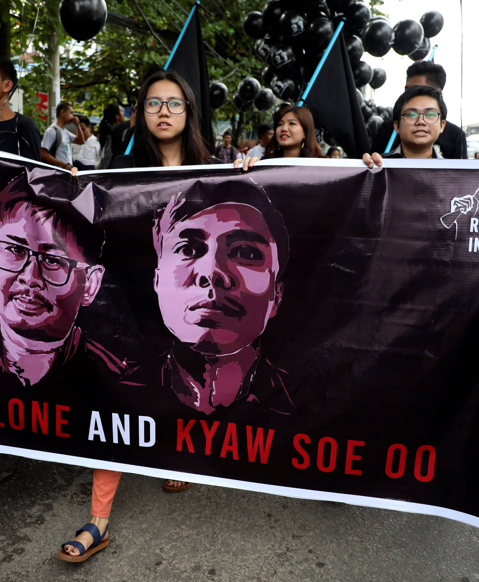 People march to show solidarity for jailed Reuters journalists Wa Lone and Kyaw Soe Oo in Yangon