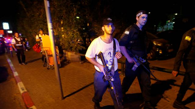 Israeli security personnel search the area following a shooting attack in the center of Tel Aviv