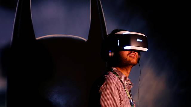 People try the new Sony VR headset during Sony Corporation's PlayStation 4 E3 2016 event in Los Angeles