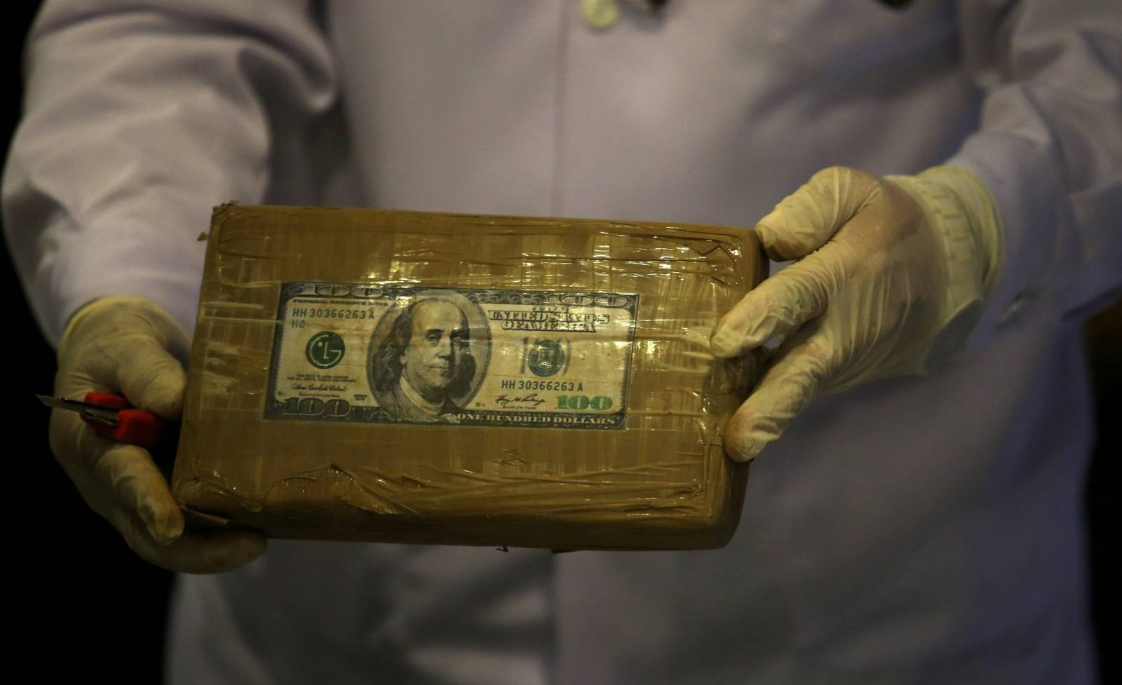 FILE PHOTO: A cocaine brick seized during an operation is displayed to the media at the Peruvian police headquarters in Lima
