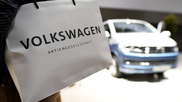 A Volkswagen shareholder carries a bag at the annual shareholder meeting in Hanover