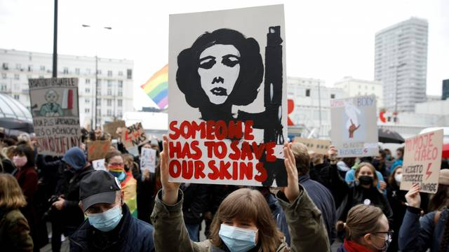 FILE PHOTO: People take part in a protest against the ruling by Poland's Constitutional Tribunal that imposes a near-total ban on abortion in Warsaw