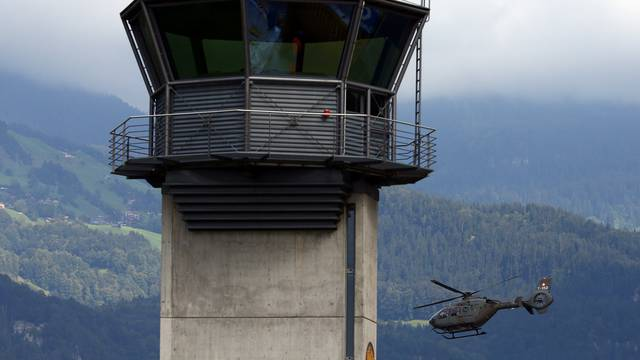 A Swiss Army Airforce helicopter take off next to the tower at the military airport in Meiringen