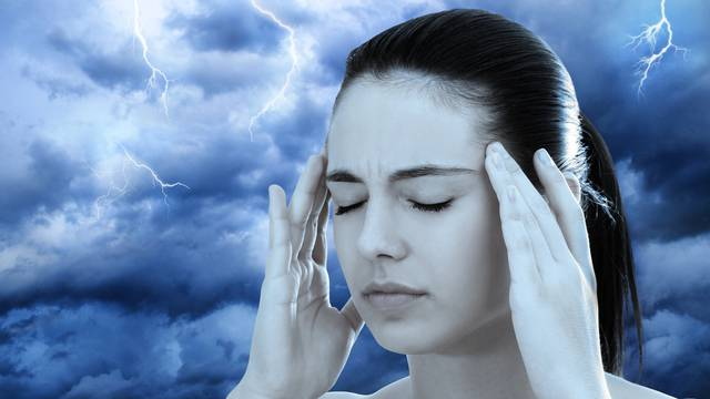 Conceptual image of woman meditating against stormy background.