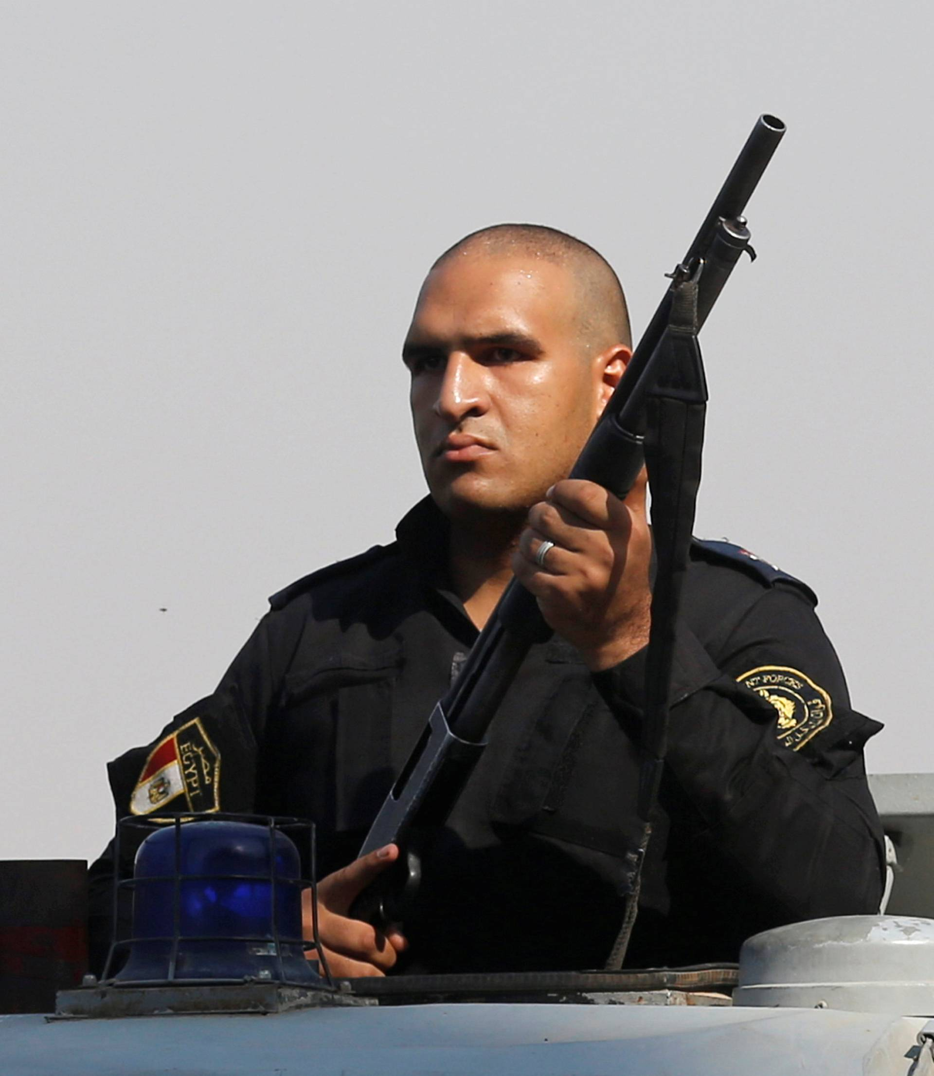 A special police officer stand on a police car during the funeral of Syed Tafshan in the south of Cairo