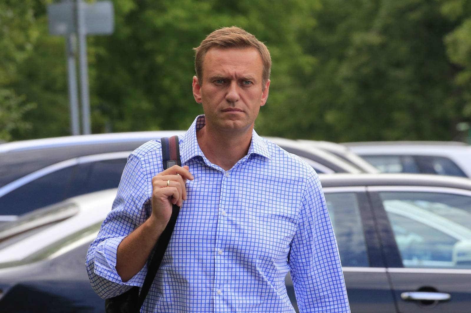 FILE PHOTO: Russian opposition leader Navalny walks before a court hearing in Moscow