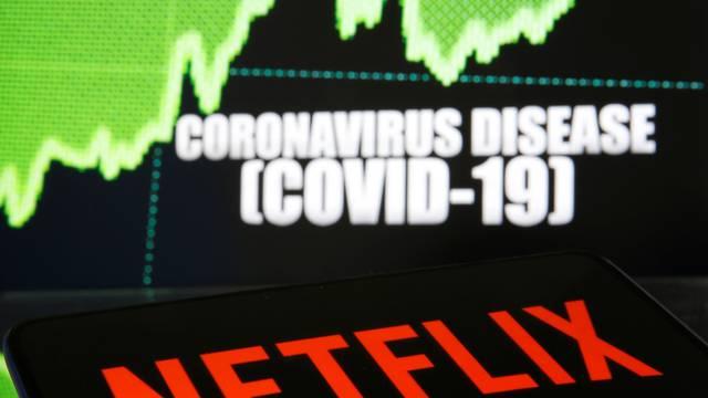 Netlix logo is seen in front of diplayed coronavirus disease (COVID-19)