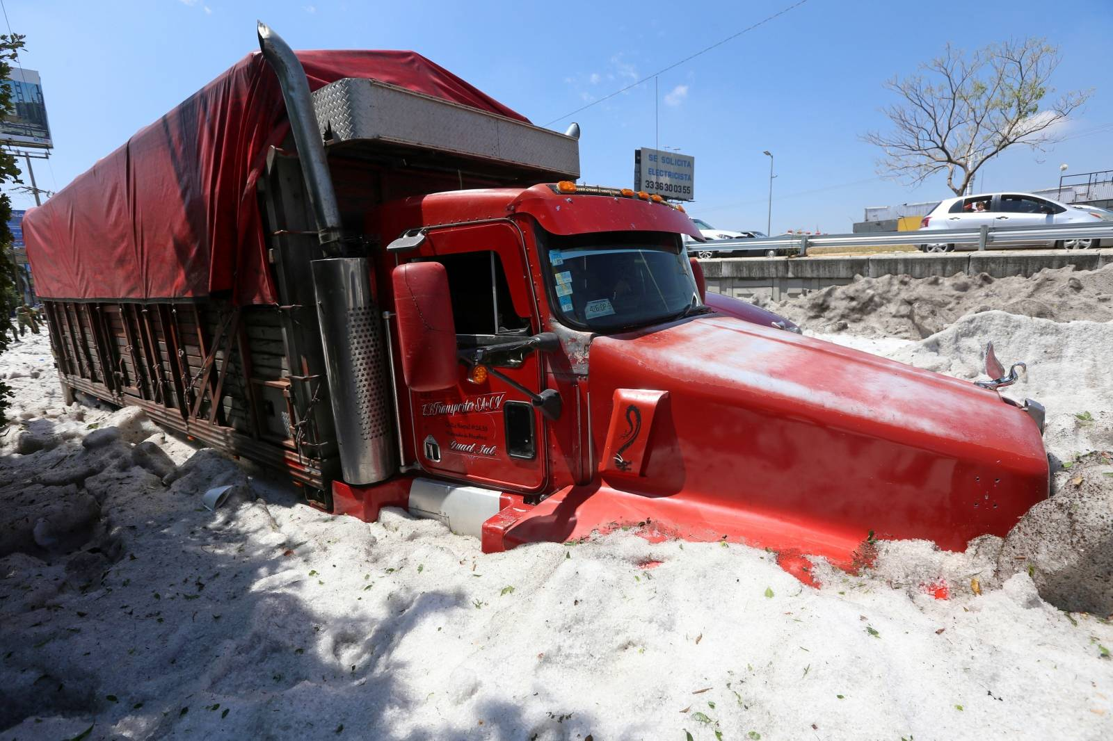A truck is buried in ice after a heavy storm of rain and hail which  affected some areas of the city in Guadalajara