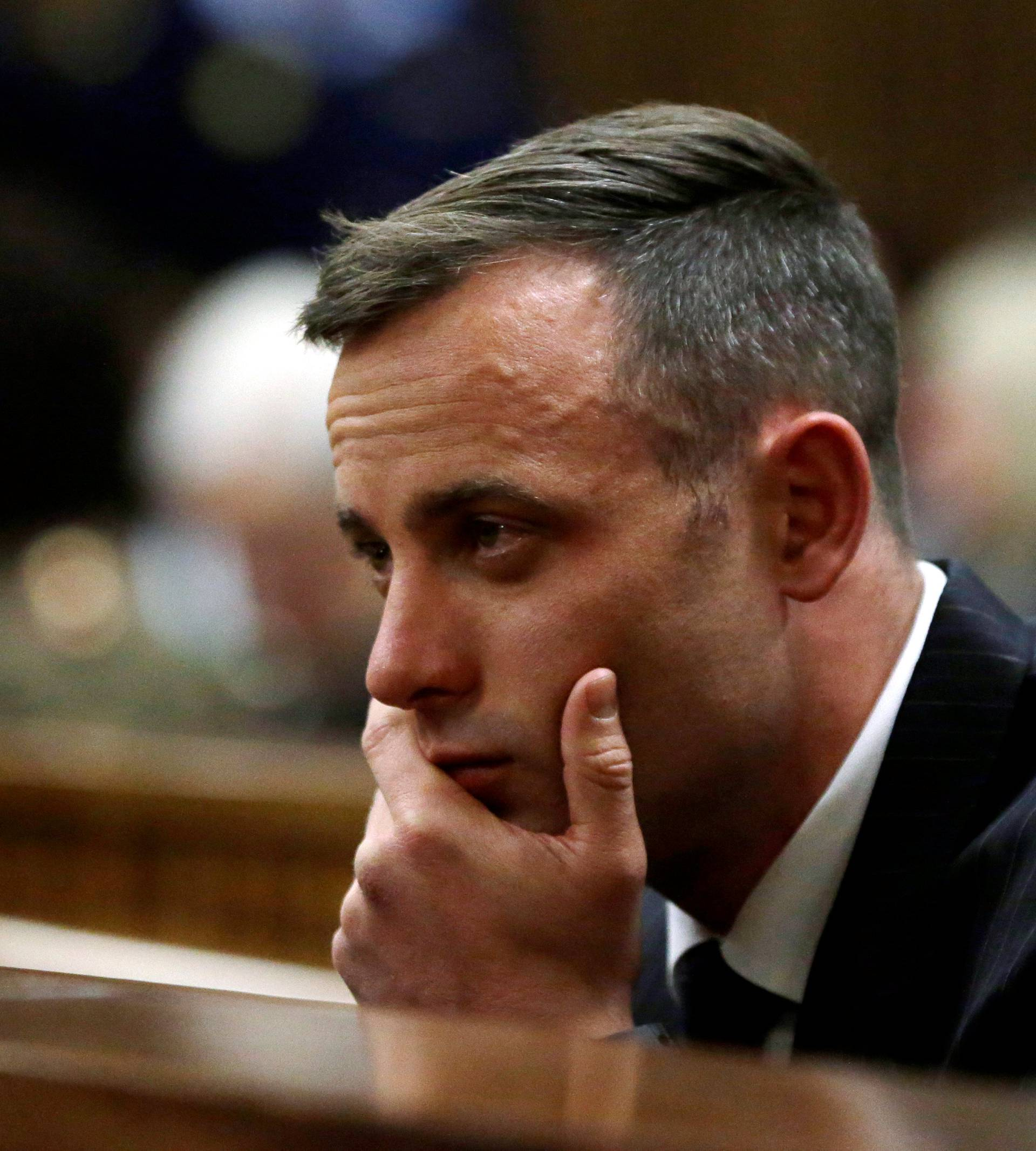 Former Paralympian Oscar Pistorius attends the sentencing for the murder of Reeva Steenkamp at the Pretoria High Court