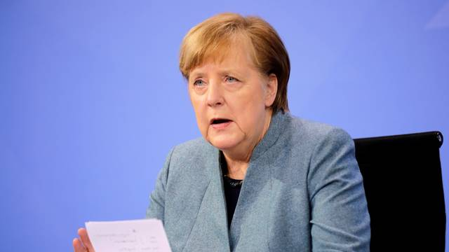German Chancellor Merkel holds a news conference in Berlin