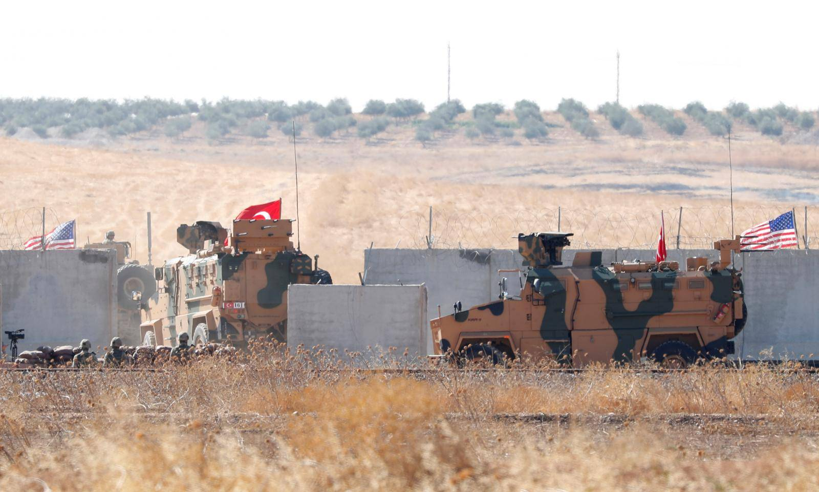Turkish army vehicles cross into Syria for a joint U.S.-Turkey patrol, near the Turkish town of Akcakale