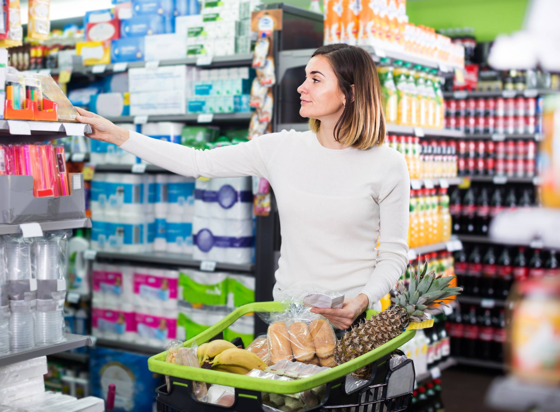 Girl customer looking at notes in shopping list