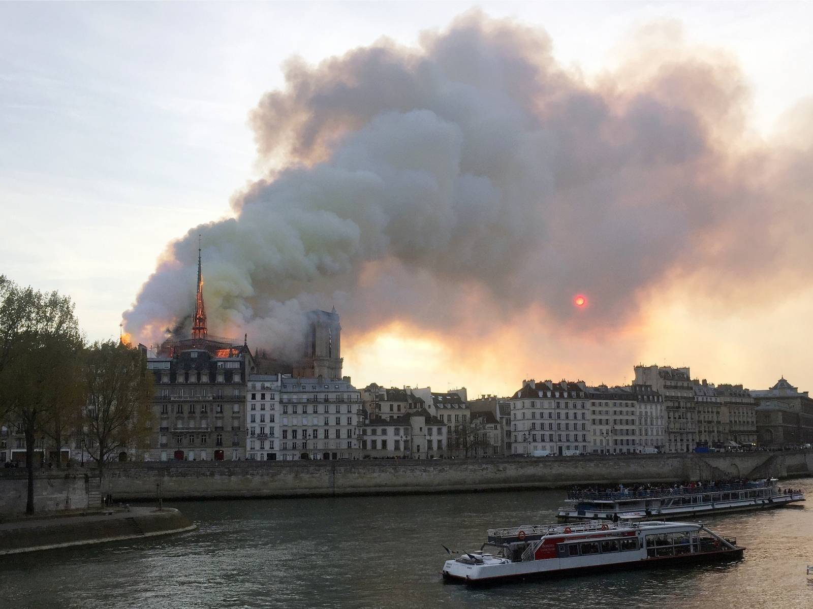 Smoke billows from the Notre Dame Cathedral after a fire broke out, in Paris