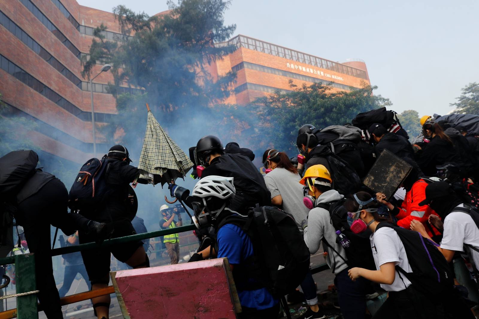 Protesters are detained by riot police while attempting to leave the campus of Hong Kong Polytechnic University (PolyU) during clashes with police in Hong Kong