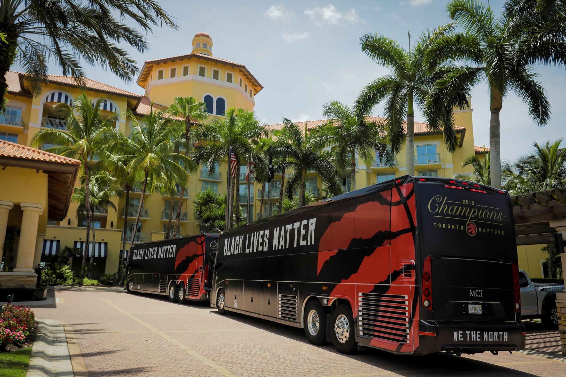 The team buses of the NBA champions Toronto Raptors basketball team arrive at the Walt Disney World complex