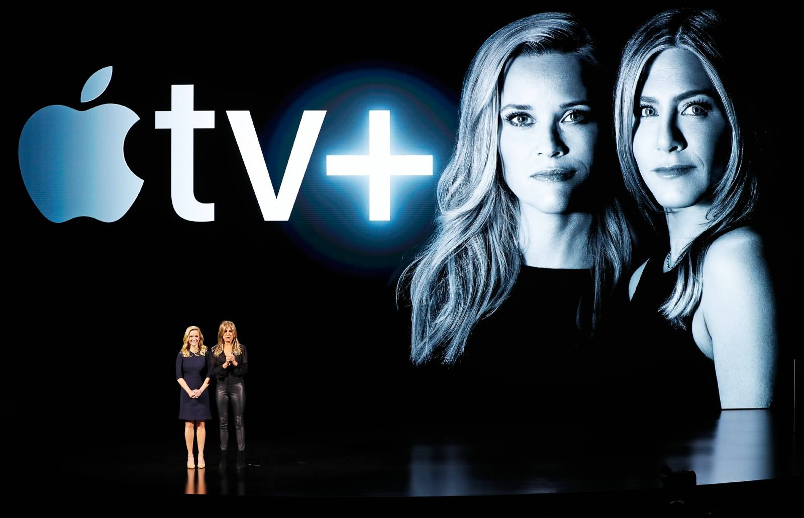 Actors Reese Witherspoon (L) and Jennifer Aniston speak during an Apple special event at the Steve Jobs Theater in Cupertino