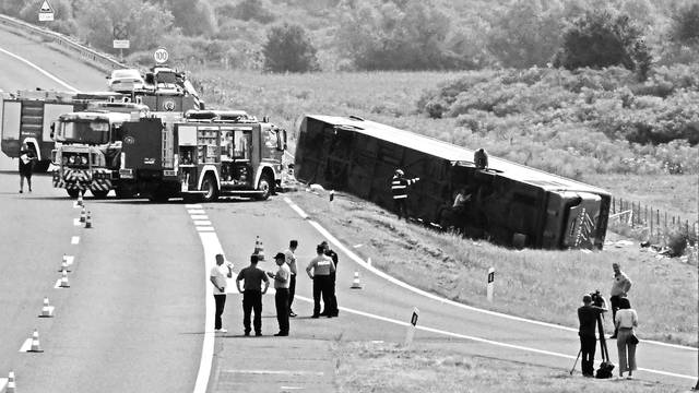 A bus driving from Germany to Kosovo is seen slipped off the road near Slavonski Brod