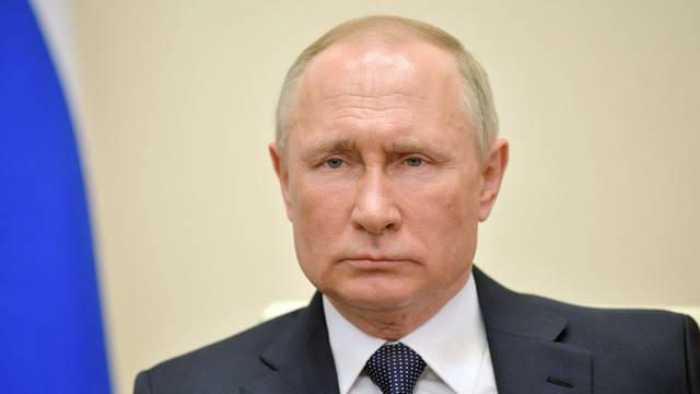 Russian PresidentPutin delivers a televised address to the nation about the coronavirus disease outbreak, outside Moscow