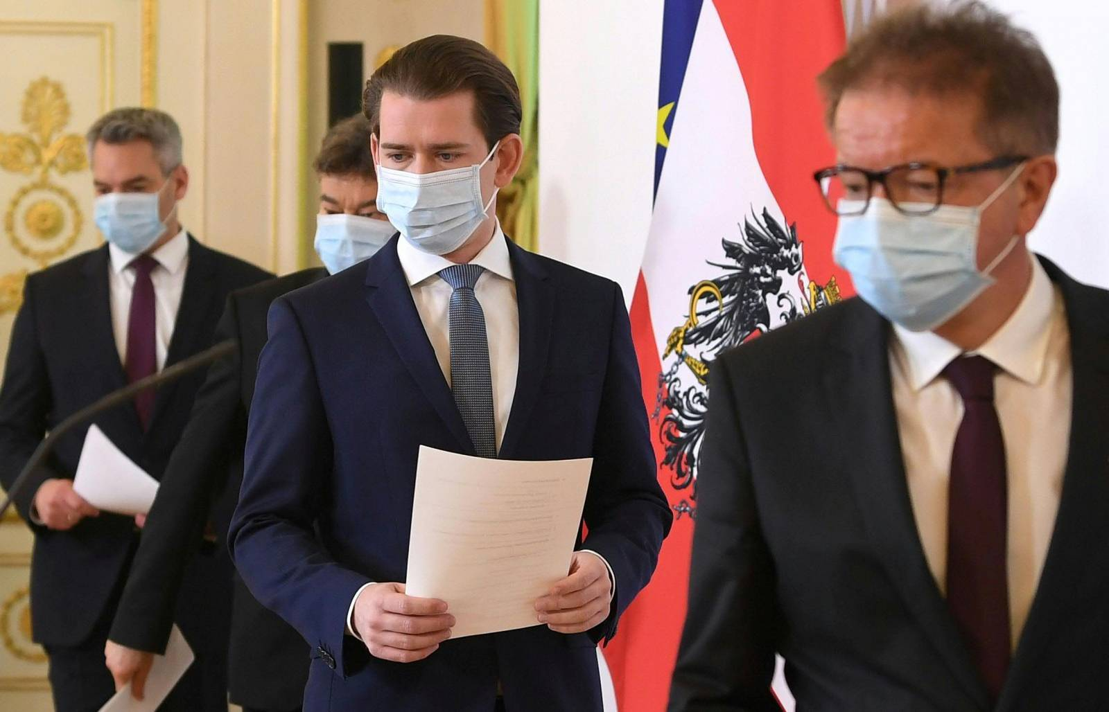 Austrian Chancellor Sebastian Kurz and Ministers arrive for a news conference in Vienna