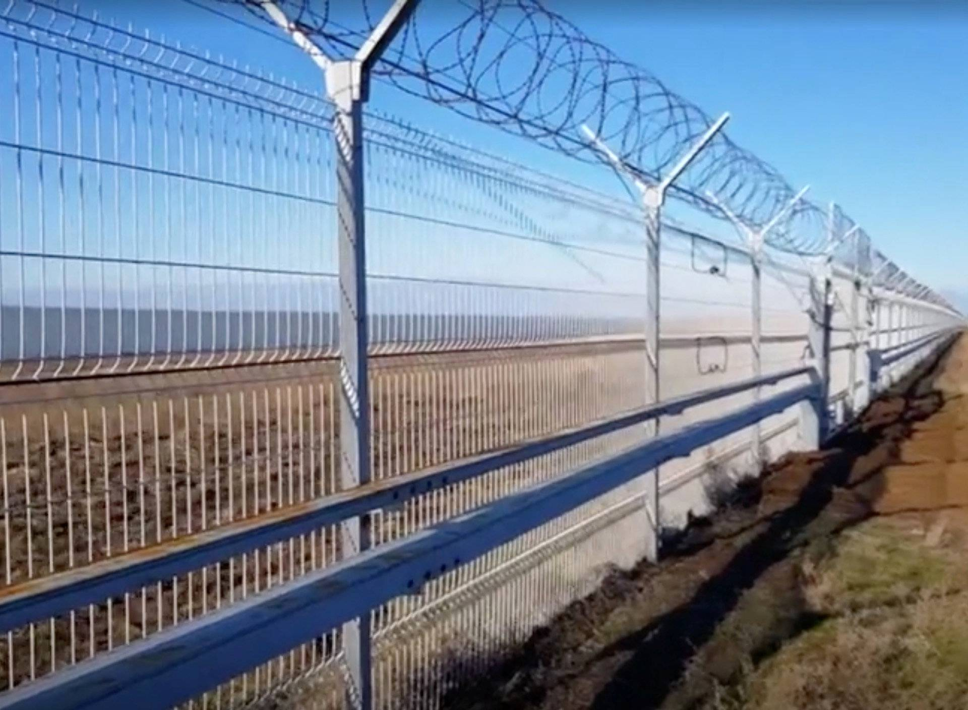 A still image taken from a video footage shows a 60-kilometre fence separating Crimea peninsula from continental Ukraine in Armyansk region