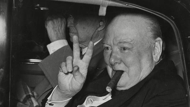 SIR Winston Churchill (1874-1965), Ex Prime Minister of Great Britain, smoking a cigar and making a victory sign.