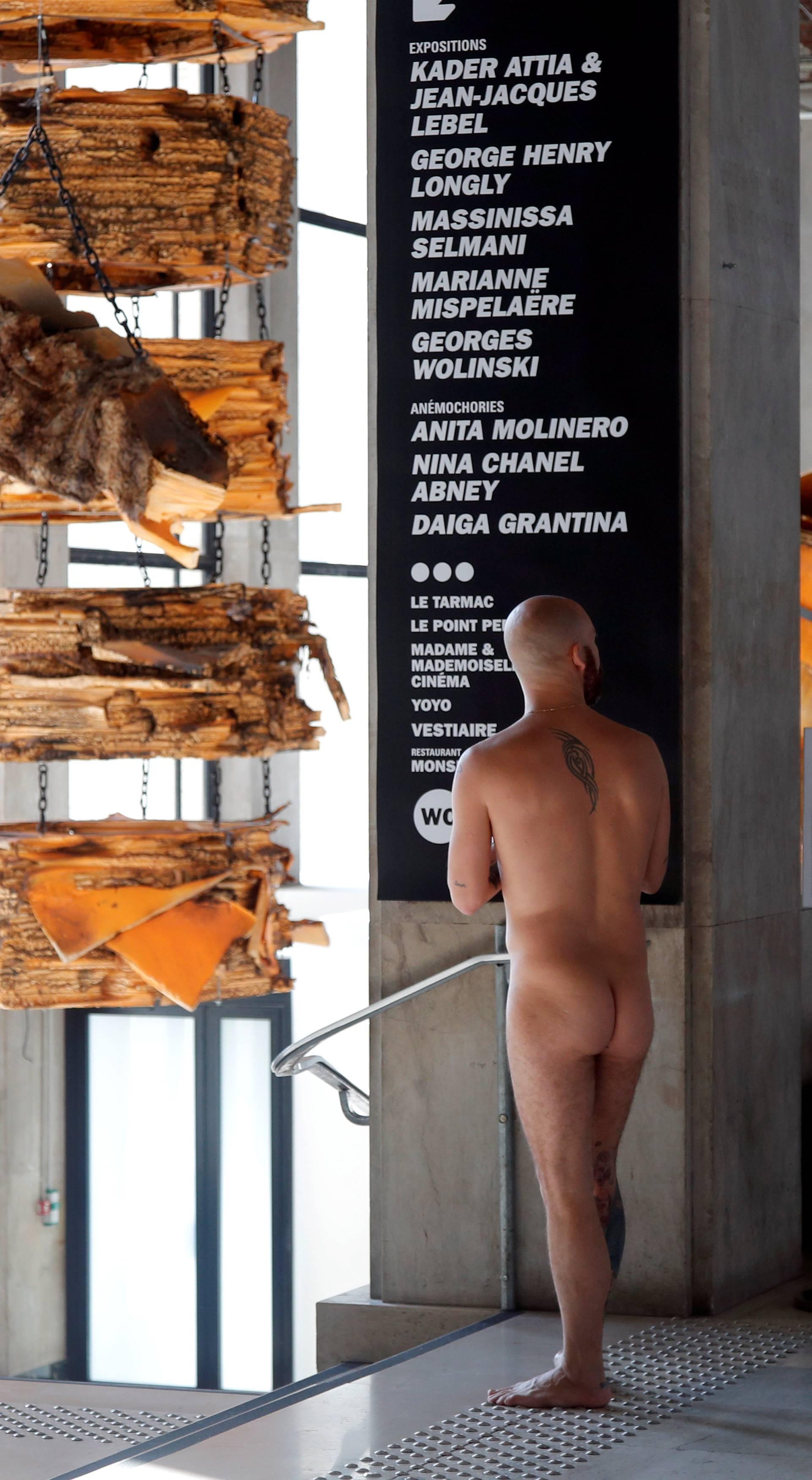 A member of the ANC (Association des Naturistes de Paris) arrives at a news conference before a nude visit of the Palais de Tokyo contemporary art centre in Paris