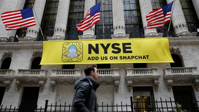 FILE PHOTO - A Snapchat sign hangs on the facade of the NYSE in New York City