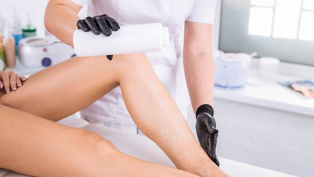 Master in depilation using professional cosmetics for depilation