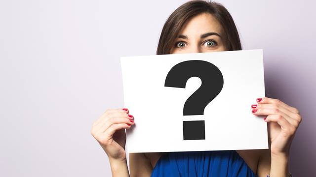 Girl,Holding,A,Signboard,With,A,Question,Mark