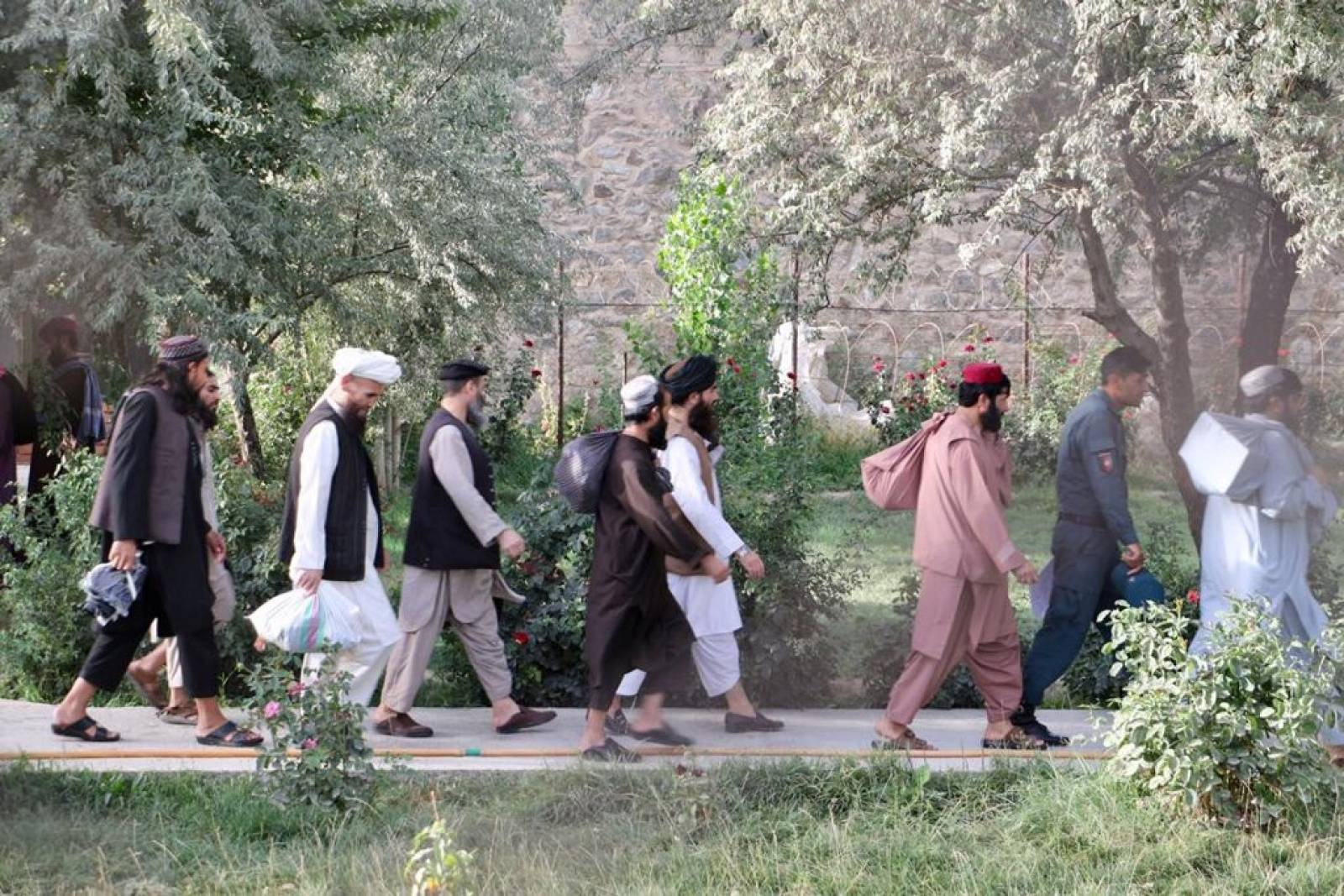 Newly freed Taliban prisoners walk at Pul-e-Charkhi prison, in Kabul