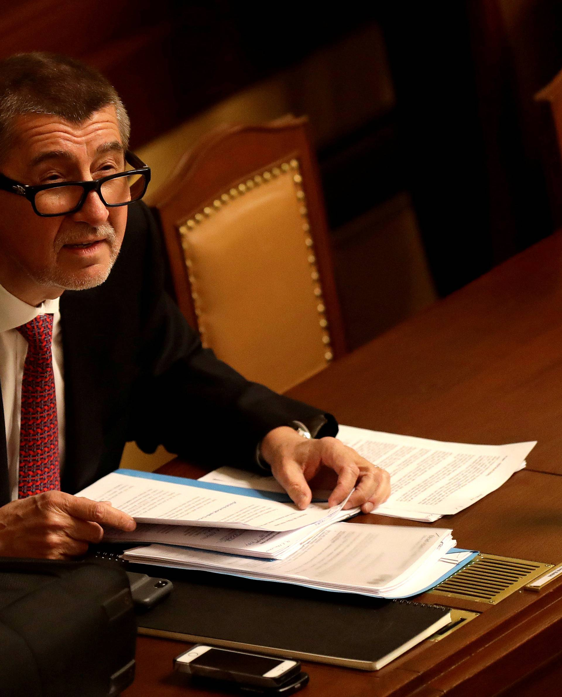 FILE PHOTO: Czech Prime Minister Andrej Babis attends a parliamentary session before a confidence vote in Prague
