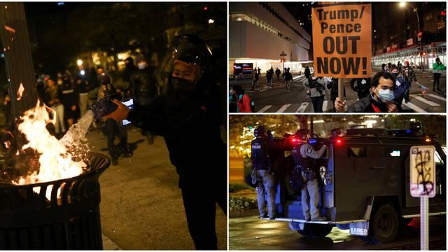 Prosvjedi diljem SAD-a: Neredi ispred Bijele kuće, ljudi se tuku, bacaju dimne bombe...
