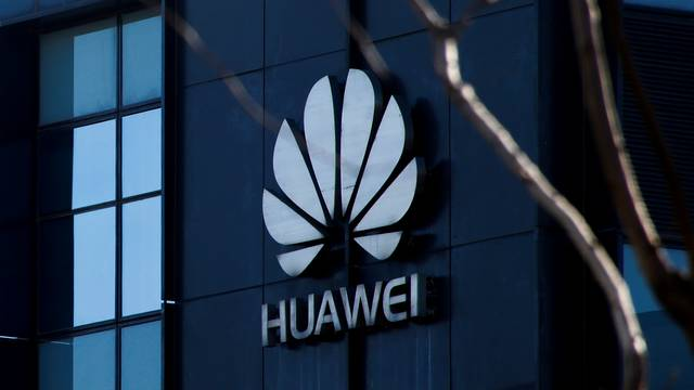 FILE PHOTO: Huawei's company logo is seen at an office in Beijing