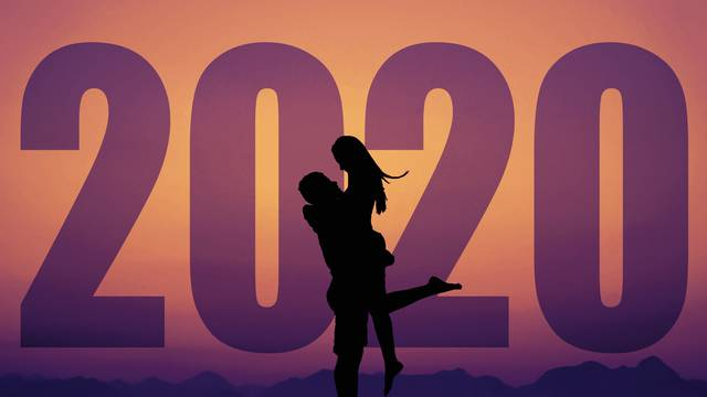 Love couple silhouette with big new year 2020 and sunset