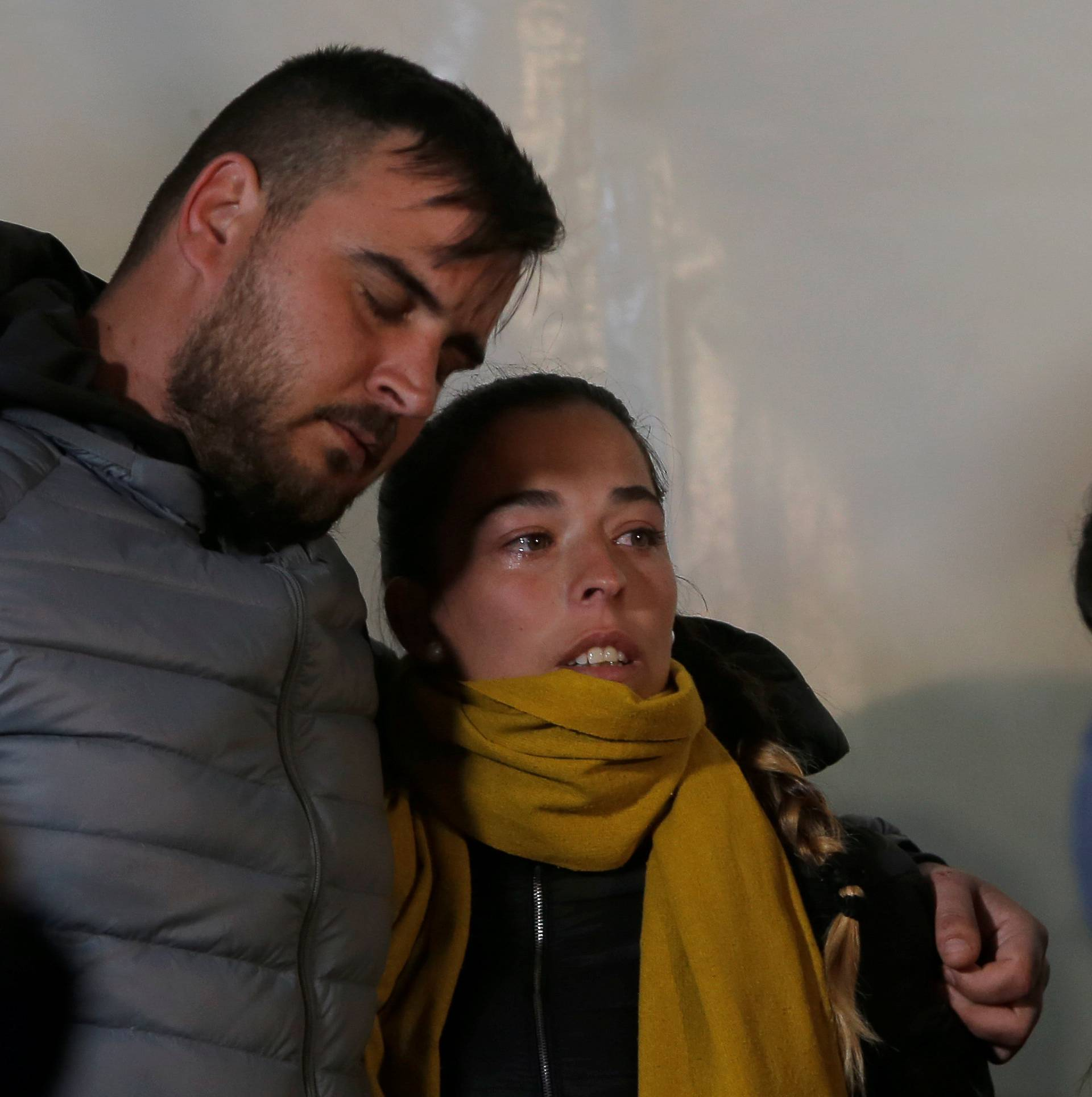 Julen's parents embrace with friends and relatives during a vigil as a miner rescuer team descends into a drilled well at the area where Julen, a Spanish two-year-old boy, fell into a deep well, in Totalan