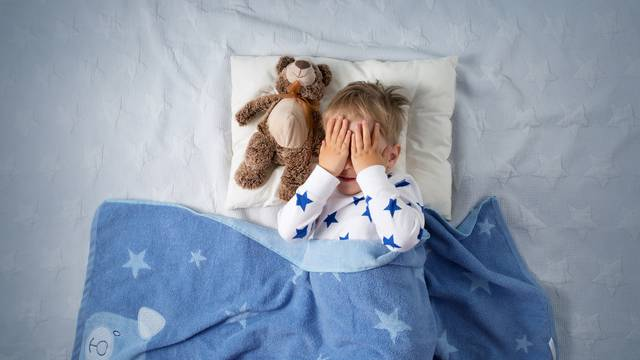Three years old child crying in bed