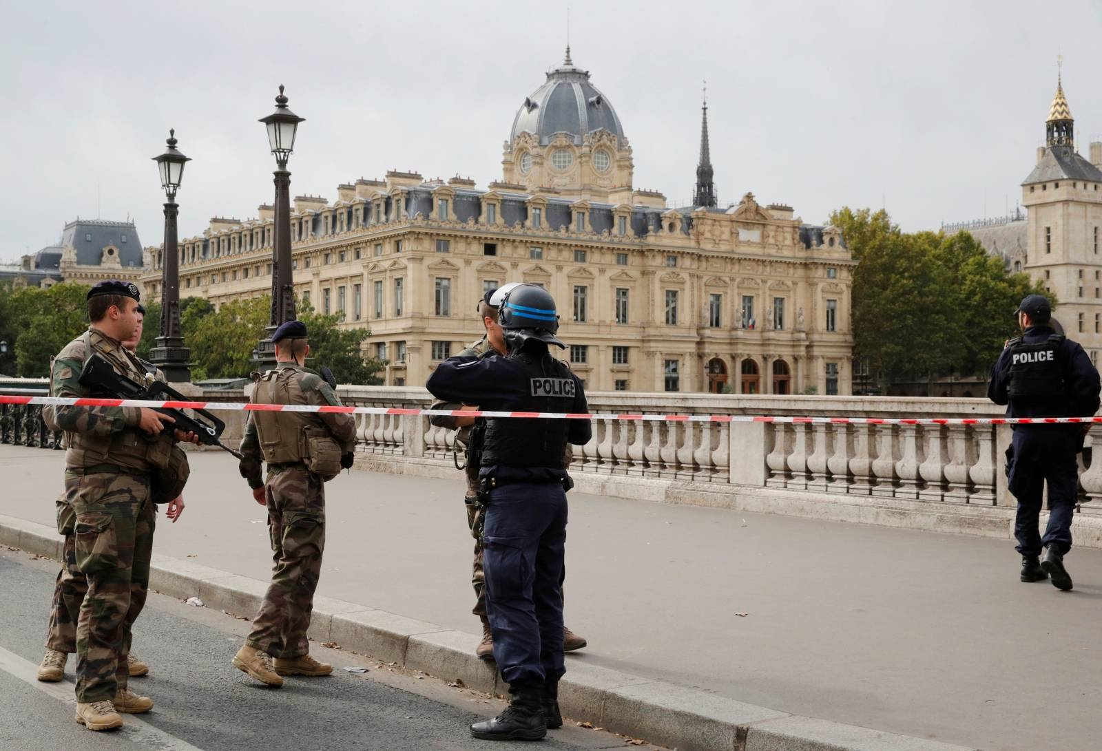 French police secure the area in front of the Paris Police headquarters in Paris