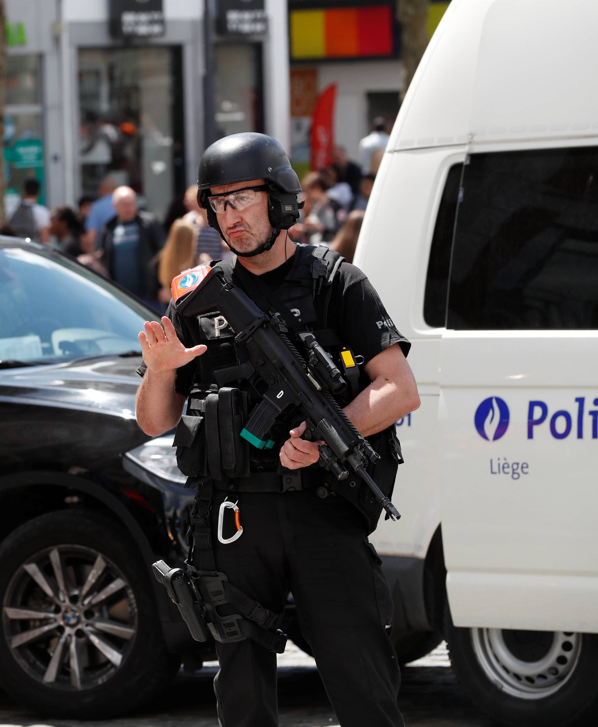 A member of the special police forcess gestures in Liege